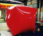large cube shaped balloons Muskegon, MI - red color cube shaped helium balloon for trade show.
